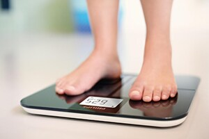 Stood on connected weighing scales