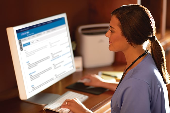 Download image (.jpg) A respiratory therapist views oxygen patient data through Care Orchestrator, Philips remote patient management system (opens in a new window)