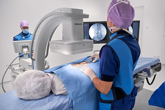 Download image (.jpg) Philips Zenition in use during a spine procedure (opens in a new window)