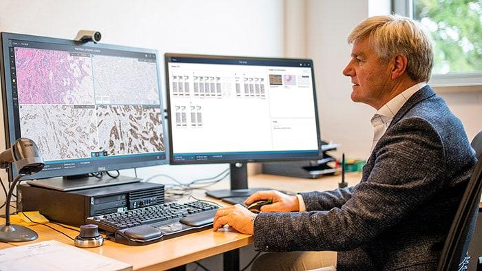 Download image (.jpg) Pathologist reviewing histopathology slides